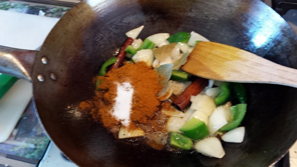 Spices and salt added to the pan