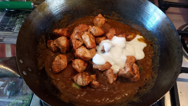 Cooked chicken and yogurt added to pan