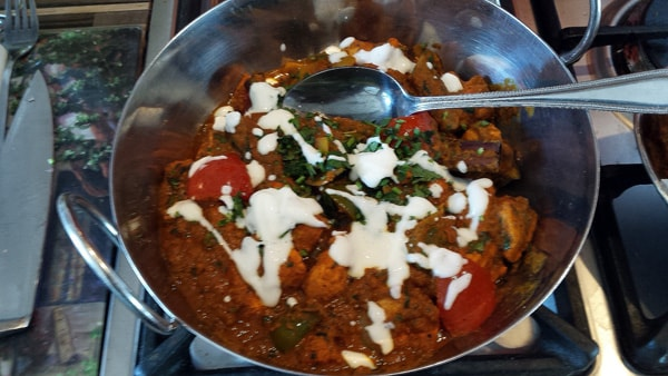 The top of the Balti has been drizzled thinly with yogurt